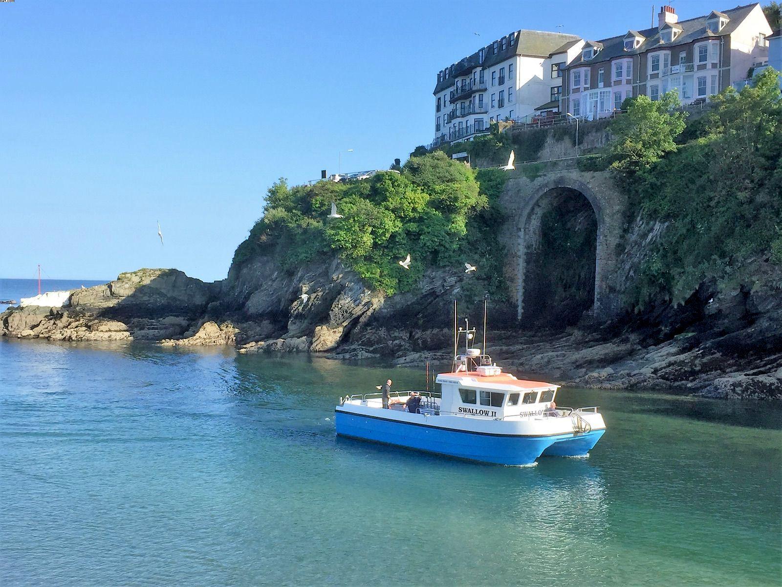 Swallow fishing boat returning to Looe River Cornwall