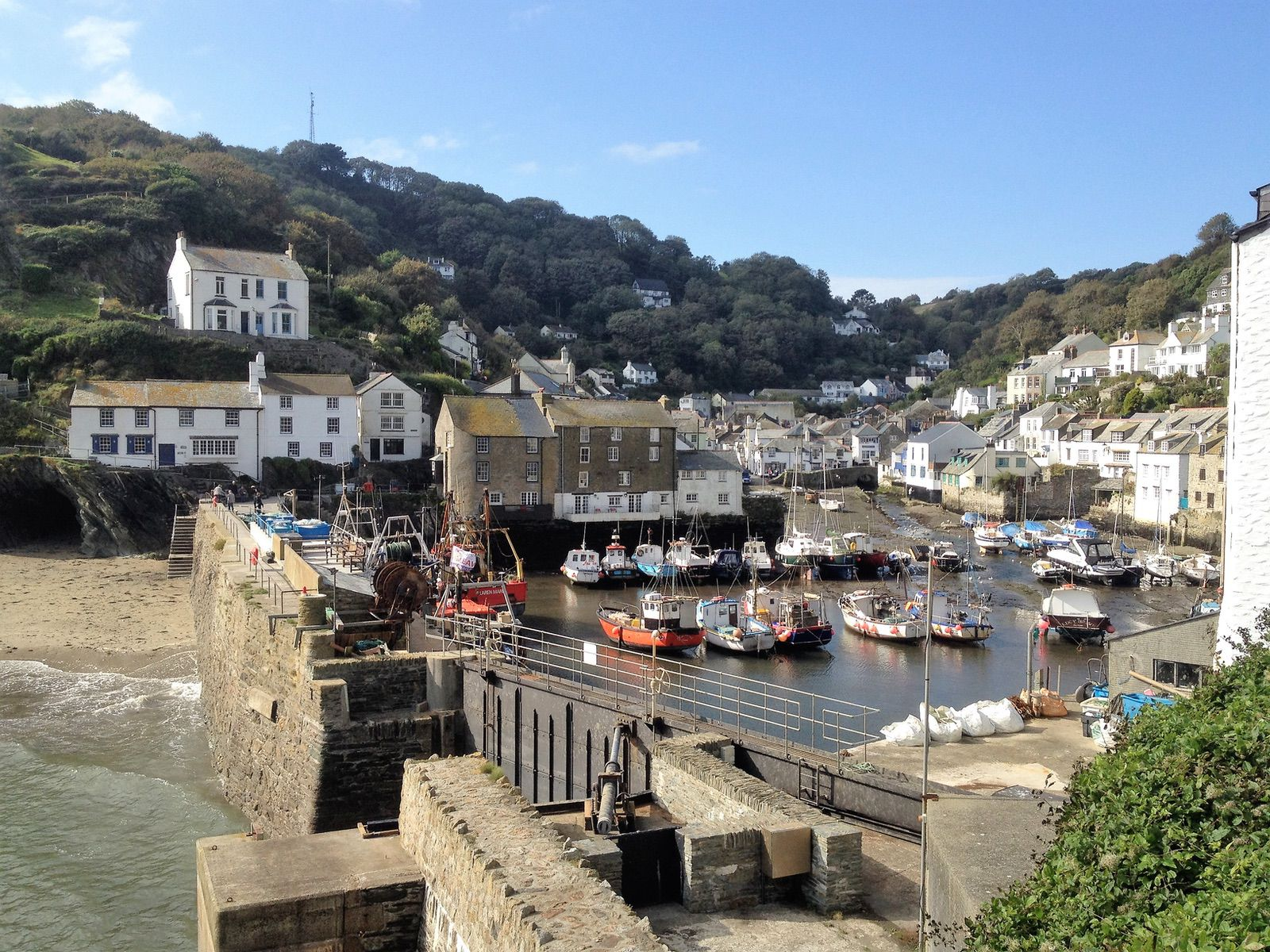 Boats in the harbour at Polperro Fishing Village on a day out from Looe