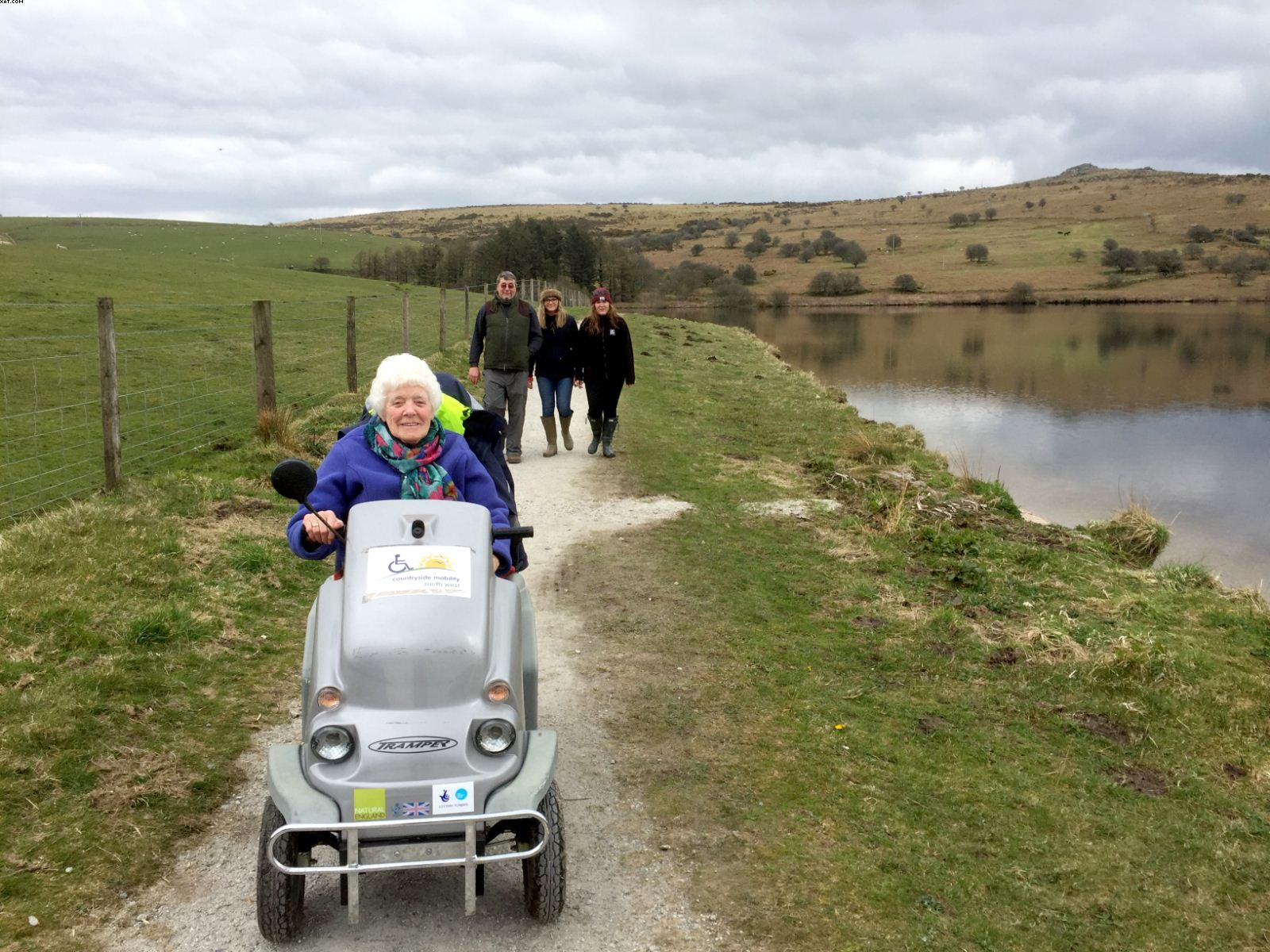 Woman on Countryside Mobility Scheme scooter at Siblyback Lake Cornwallyback